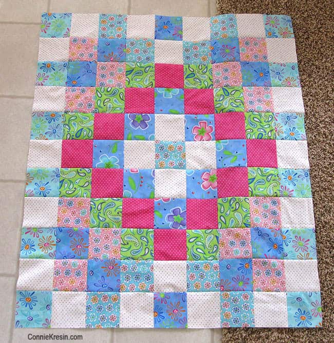 Twister Baby Quilt Tutorial sewn rowss