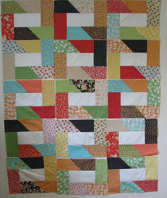 Dovetail quilt blocks on design wall