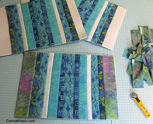 Batik QAYG placemats tutorial adding last strips