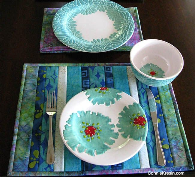 Batik QAYG placemats tutorial on table