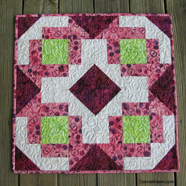 Churn Dash table topper quilted