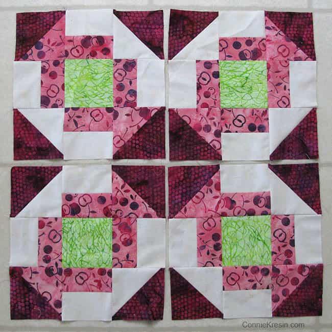 4 Churn Dash quilt blocks