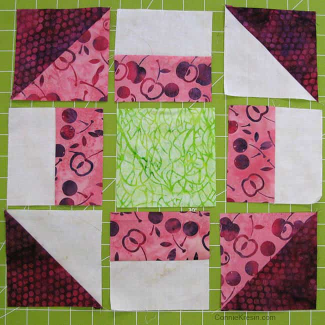 Churn Dash quilt block green center
