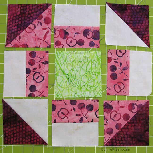 Churn Dash quilt block green center