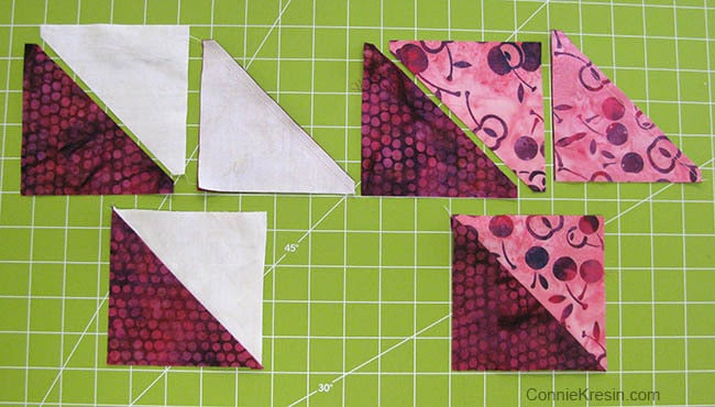 Cutting the half square triangles with the AccuQuilt Die