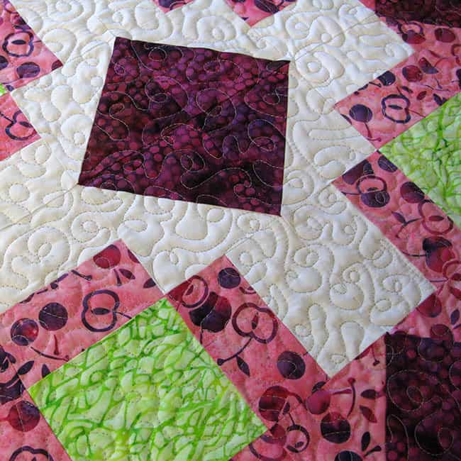 Churn Dash quilted table topper closeup