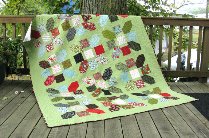 Jolly Bar Jazz free quilt tutorial shown on deck