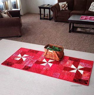 Red Pinwheel batik tablerunner on kitchen island
