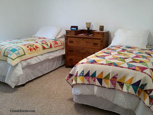 Spare room beds with quilts