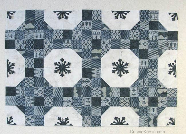 Alpine Ice AccuQuilt snowflakes on quilt