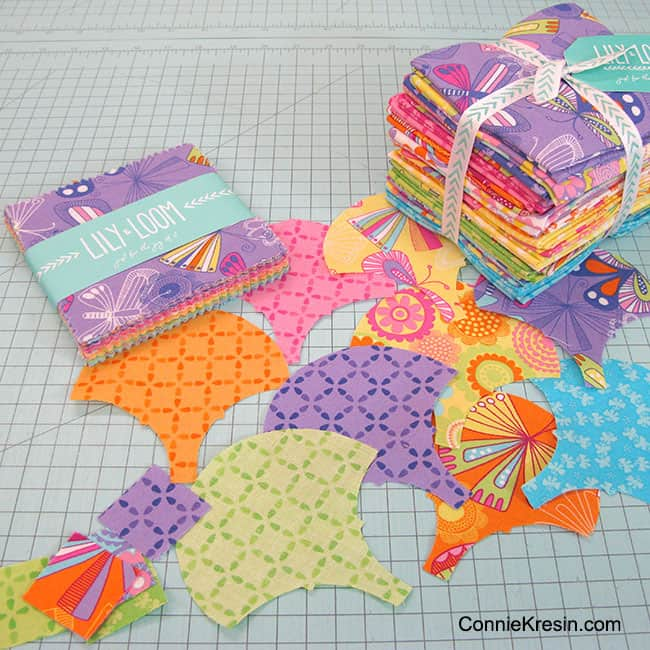 Lily and Loom Charm squares and the AccuQuilt GO! Clamshell die for a scrap quilt project #AccuQuilt #Quilt
