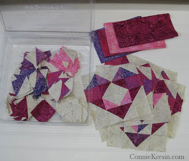 Box of batik fabric and blocks