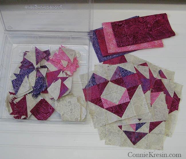 Box of batik fabric and blocks