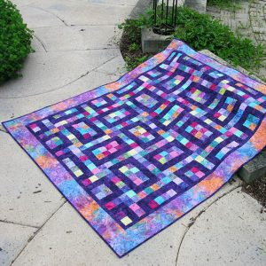 Hopscotch Quilt Pattern fast and easy to make #quilt #batiks #pattern #quilting