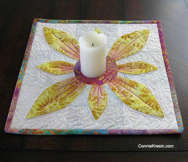 Applique Flower Candle Mat in batiks