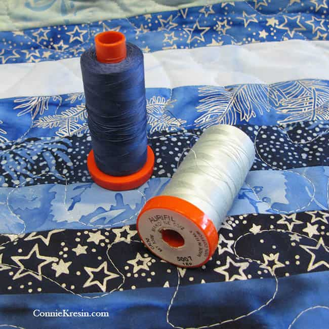 DIY Skinny Blue Batik Strips Tablerunner Tutorial #IslandBatik #Aurifil #Quilting #DIY #batiks #tutorial #tablerunner