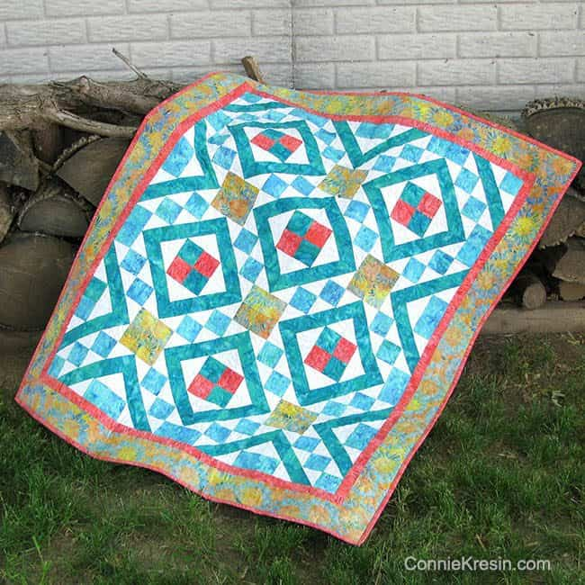Diamond Maze is a beautiful quilt pattern shown on the rocks by the tree in Island Batik fabrics easy to make #quilt #quiltpattern #batiks #islandbatik