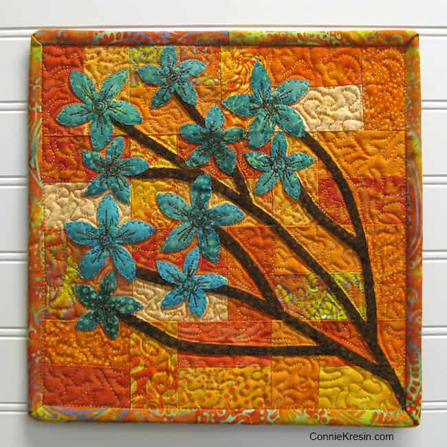 Quilted and appliqued batik Chinese Forget Me Not quilt tutorial