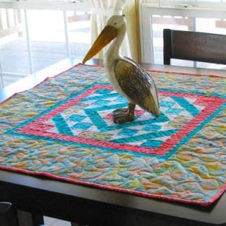 Diamond Maze table topper on table with a pelican on it