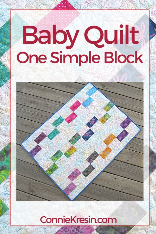 One Simple Quilt Block named Painted Window easily makes a beautiful baby quilt in batiks