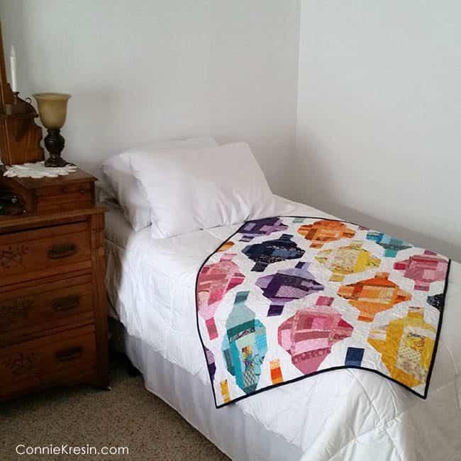 Stash Statement Grand Bazaar quilt bed