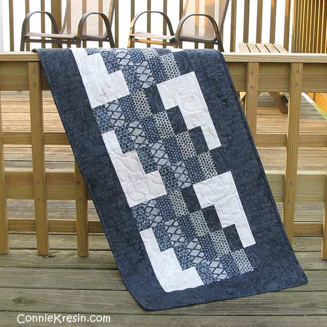 Quilted Swirly tablerunner on deck rail
