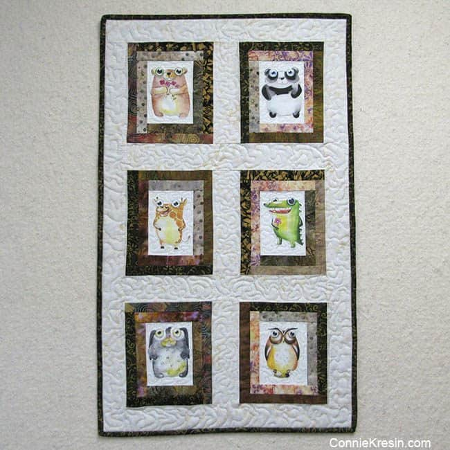 6 cute printed animals on quilt