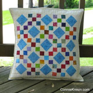 Scrappy batik 9 patch pillow