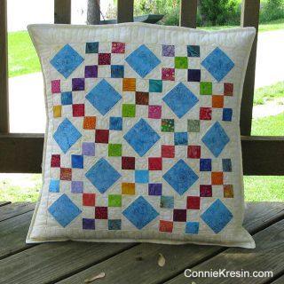 Scrappy batik 9 patch pillow