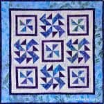 Spinners quilt pattern in batiks