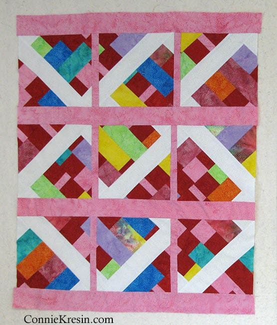 Adding borders to the scrappy batik quilt