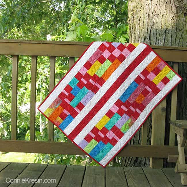 Batik baby quilt on rail