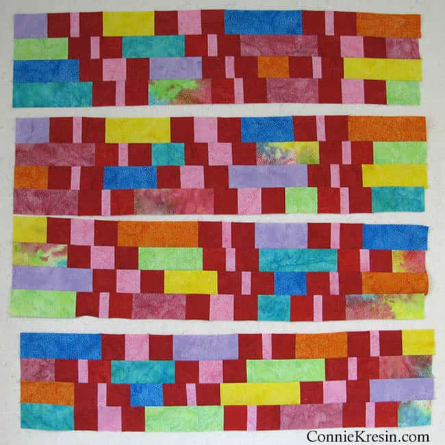 Creating more rows of batiks strips for quilt