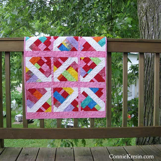 Modern Baby Quilt in batiks Embers on deck rail