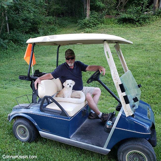 Bob and Sadie riding the golf cart