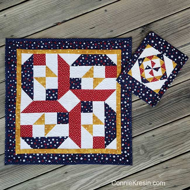 Quilts made with red gold blue and white fabrics