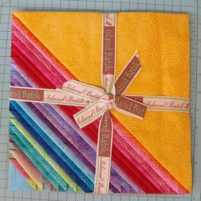 Island batik Ambassador Stack of Paisley Dot Brights quilt fabric