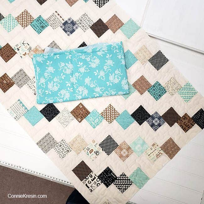 Mini Falling Charms quilted tablerunner choosing the binding fabric