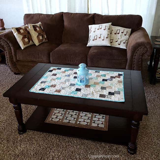 Mini Falling Charms quilted tablerunner on living room table