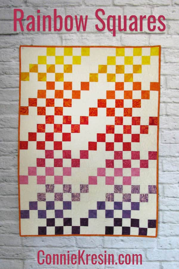 Rainbow Squares baby quilt is fast and easy to make shown in batiks
