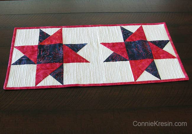Spinning Stars tablerunner on table