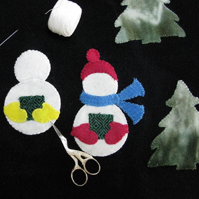 caroling snowmen wool table topper tutorial building snowmen closeup