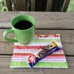 Selvage mug rug with coffee and a treat