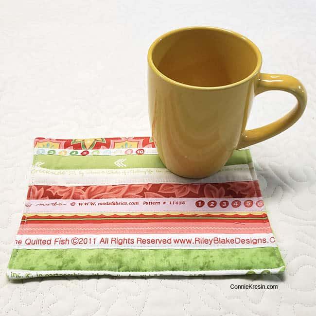 yellow Selvage mug rug with coffee