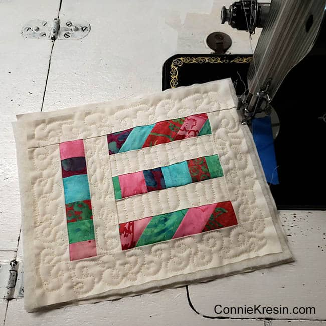 Angled Strips Mug Rug tutorial scraps being quilted