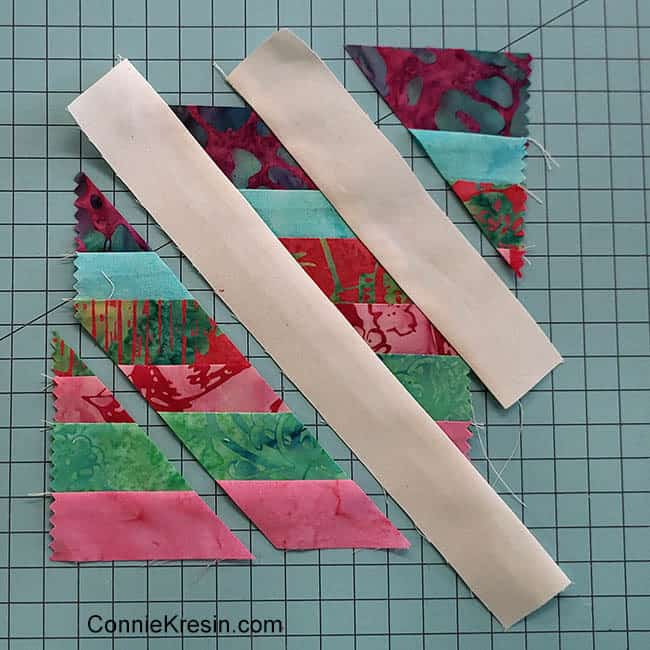 Angled Strips Mug Rug tutorial scraps being sewn together