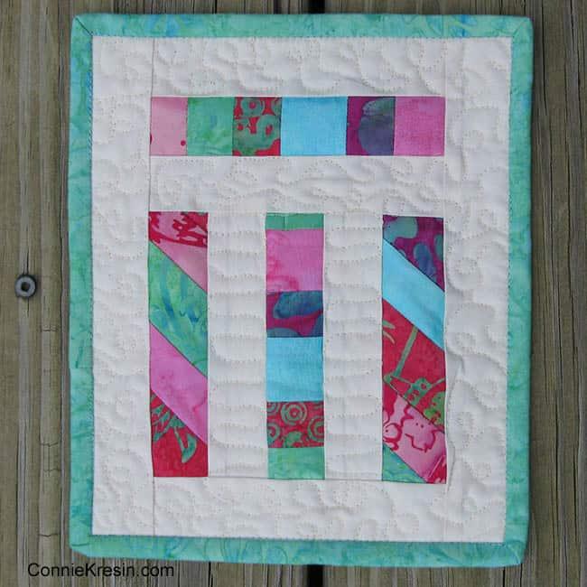 Teal angled strips mug rug quilt tutorial on design wall