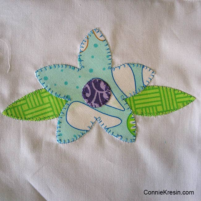 Applique Floral Baby quilt is easy to make shown appliqued
