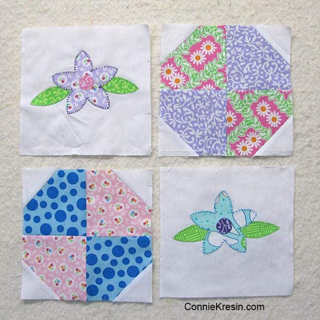 Applique Floral Baby quilt is easy to make shown appliqued for rows
