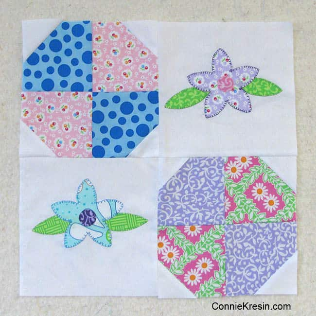 Floral applique baby quilt sewing 4 quilt blocks together